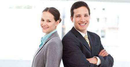 Photo pour Happy partners posing togetherback to back - image libre de droit