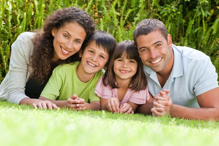 Photo for Happy family lying down in the garden - Royalty Free Image