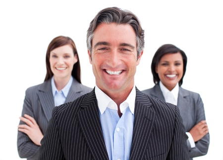 Self-assured businessman posing in front of his team