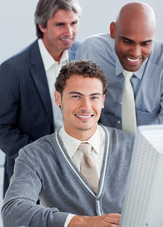 Handsome businessmen working at a computer