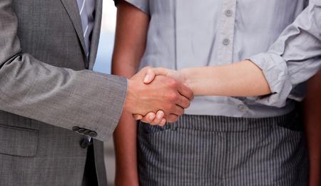 Close-up of a lucky businessteam closing a deal
