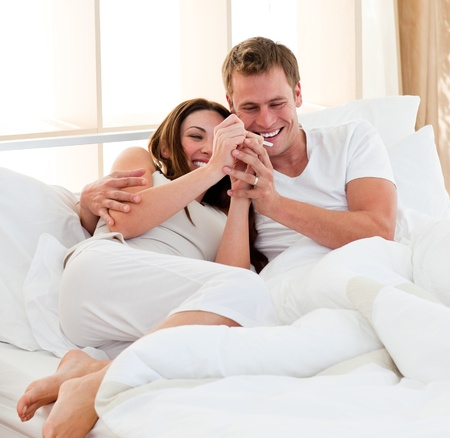 Lively couple finding out results of a pregnancy test
