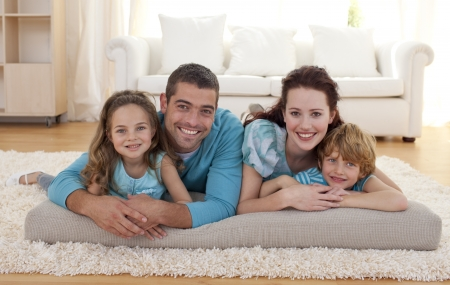 Photo for Family on floor in living-room - Royalty Free Image