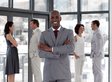 Afro-american male leader with his team