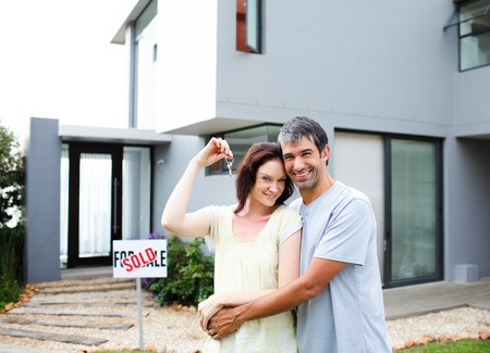Happy couple after buying house