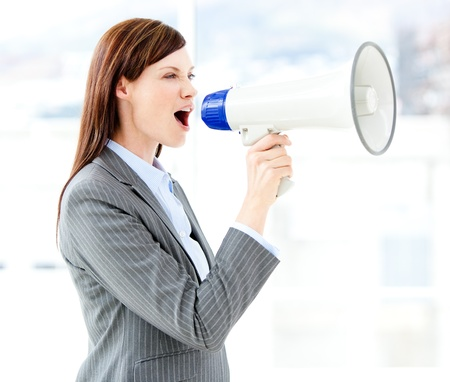 Photo for Portrait of an beautiful businesswoman using a megaphone  - Royalty Free Image