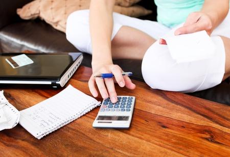 Beautiful woman doing accountancy