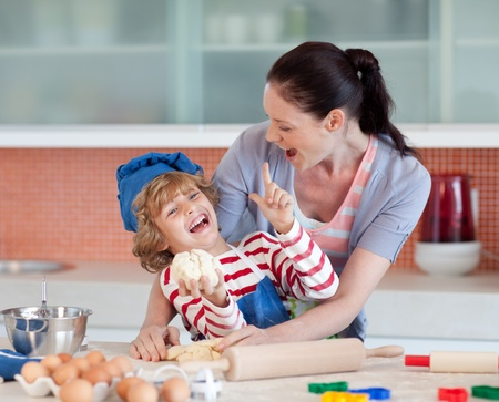 Photo for Laughing family having fun in the kitchen  - Royalty Free Image