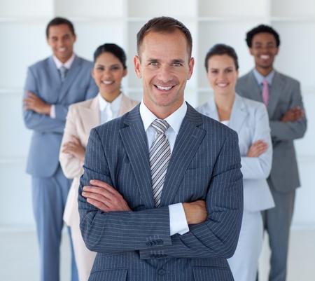 Foto de Business manager standing in office leading his team - Imagen libre de derechos