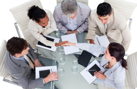 Cute multi-ethnic business team closing a deal