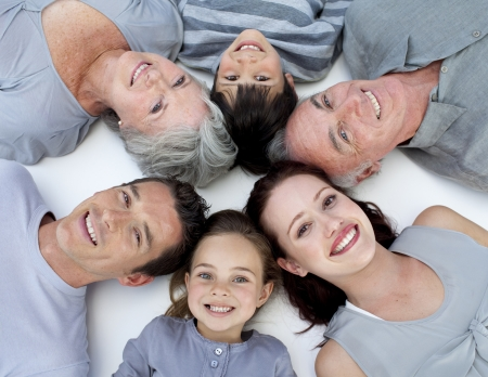 High angle of family lying on floor with heads together
