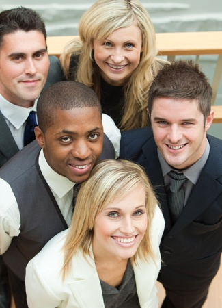 High view of a business team smiling at the camera. Concept of union in business