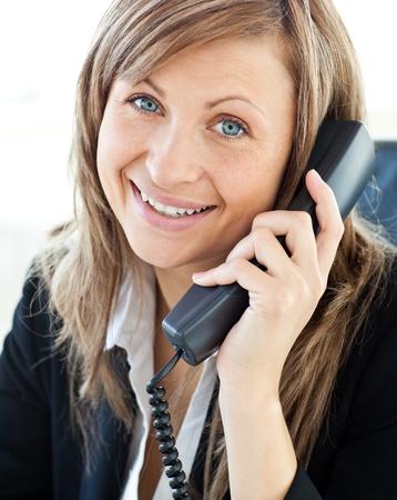 Photo pour Portrait of a beautiful businesswoman talking on phone - image libre de droit