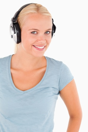 Portrait of a smiling woman with headphones in a studio
