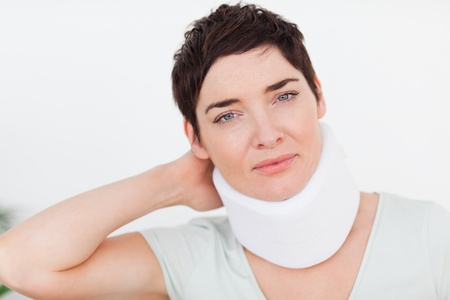 Close up of a woman with a surgical collar in a waiting room