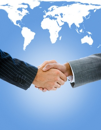 Close-up of a business people shaking hands against a white background