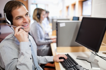 Smiling assistant using a headset in a call center