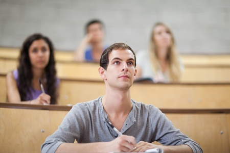 Students listening during a lecture in an amphitheater