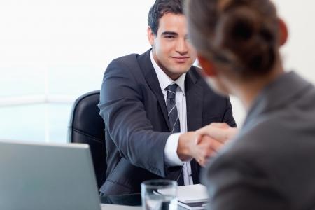 Photo pour Manager interviewing a female applicant in his office - image libre de droit
