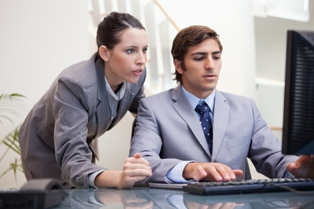 Young business team looking at computer screen together