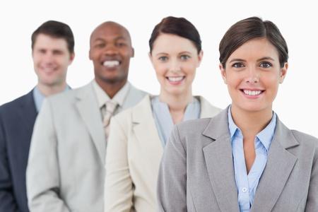 Photo pour Smiling young businessteam standing against a white background - image libre de droit
