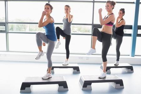 For women raising their leg swhile doing aerobics in gym