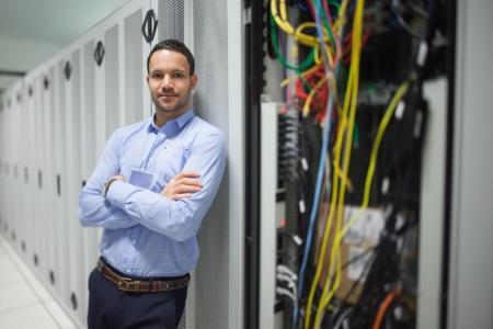 Man leaning against server locker in data center