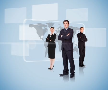 Business people standing in front of a map arms crossed