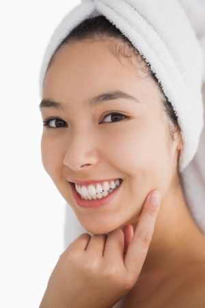 Woman wearing a towel for her hair while smiling