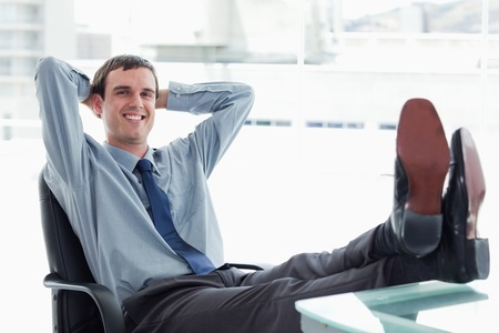 Blissful manager relaxing in his office