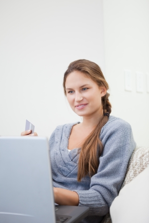 Woman sitting while using a computer indoor
