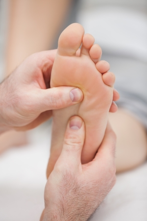 Reflexology massage being made in a room