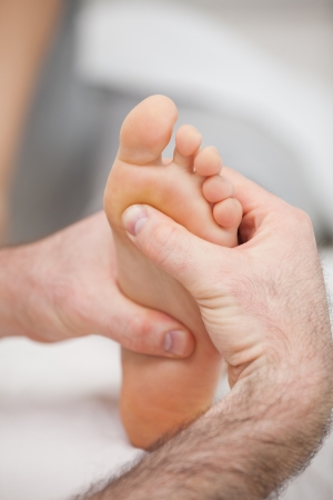 Sole of foot being massaged in a medical room