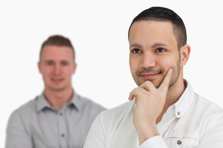 Two thoughtful men against a white background