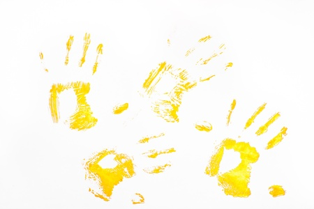 Four yellow handprints against a white background