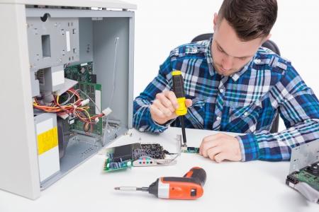 Computer engineer repairing cpu over white background