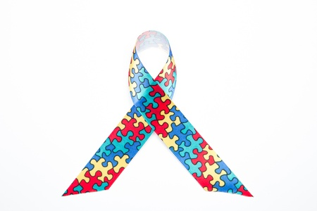 Awareness ribbon for autism and aspergers on white background