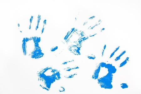 Four blue handprints against a white background