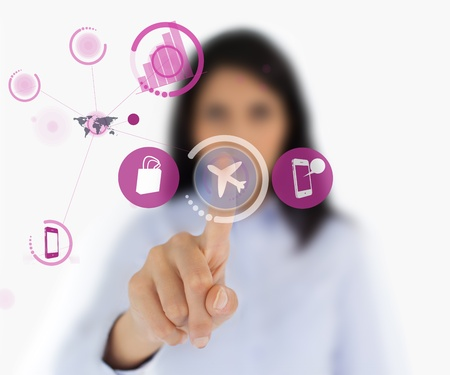 Woman selecting airplane symbol from hologram interface