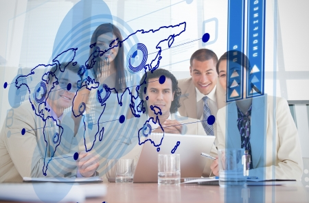 Photo pour Smiling business workers looking at blue map interface in a meeting - image libre de droit