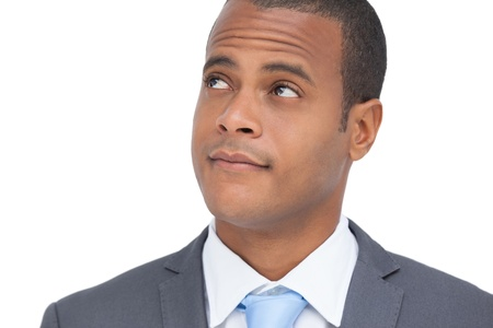 Thoughtful businessman standing on white background