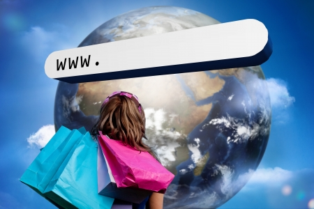 Girl with shopping bags looking at address bar with large earth in blue sky with clouds