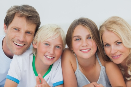 Portrait of a cheerful family lying on the bed
