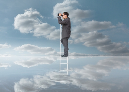 Elegant businessman standing on ladder with binoculars over a puddle on blue sky background