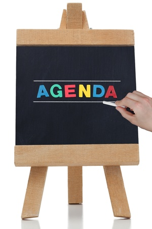 Agenda written in colored letters on a chalkboard
