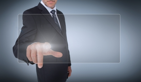 Businessman selecting a transparent screen on grey background