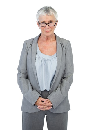 Serious businesswoman with glasses on white background