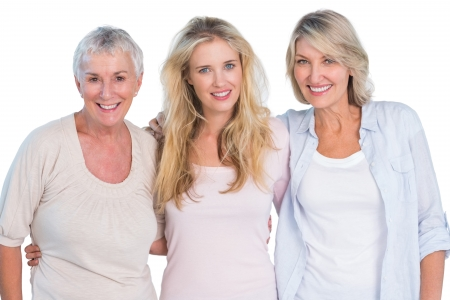 Three generations of  happy women smiling at camera on white background