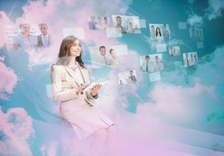 Beautiful businesswoman using digital interface while cloud computing