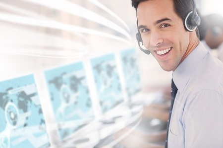 Call center worker using futuristic interface hologram smiling at camera in office
